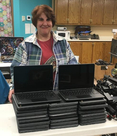 Sandra Abshire getting the new chromebooks ready to deploy.